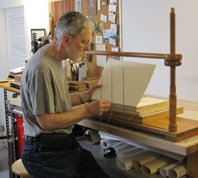 James Reid-Cunningham creating the binding
