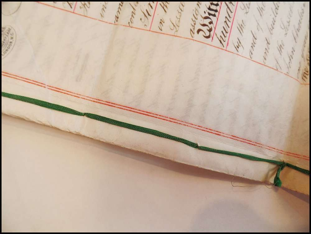 An 1889 document on vellum with ribbon binding; The Abbey Studio