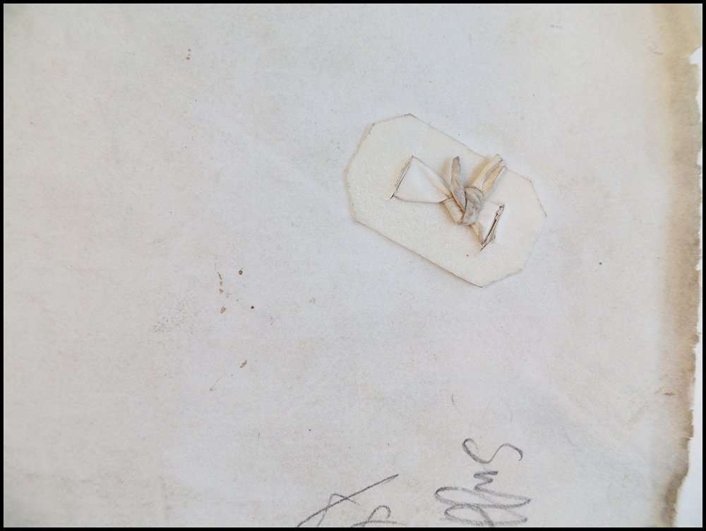 """Reverse side of a type of """"staple"""" made from vellum scraps; The Abbey Studio"""